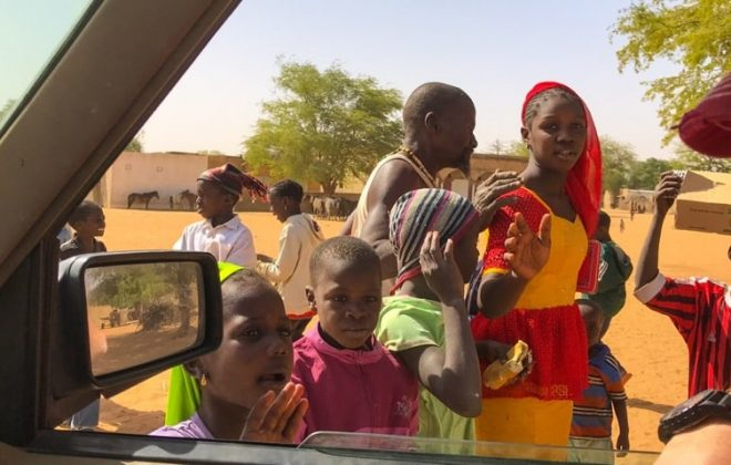 People in Senegal greet overlanders