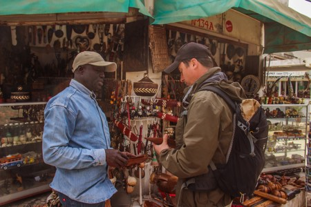 Buying handicrafts in Dakar Market - Overlanding
