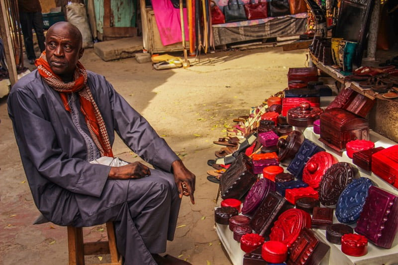 Vendor at his stall in the Dakar market - Overlanding in Africa