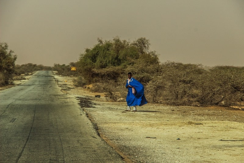 Man standing next to the road in Mauritania