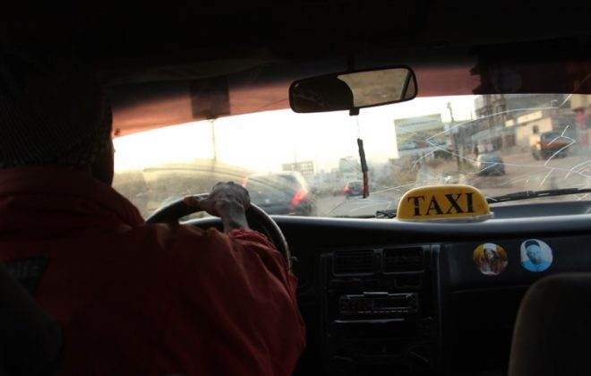Taking a taxi to visit the market in Dakar Senegal - Overlanding in Africa