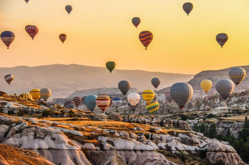 sunrise in cappadocia turkey with hot air ballooning